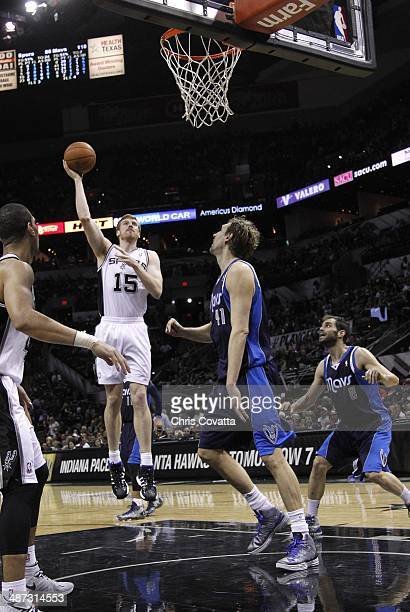 Matt Bonner of the San Antonio Spurs shoots over Dirk Nowitzki of the Dallas Mavericks in Game Two of the Western Conference Quarterfinals during the...