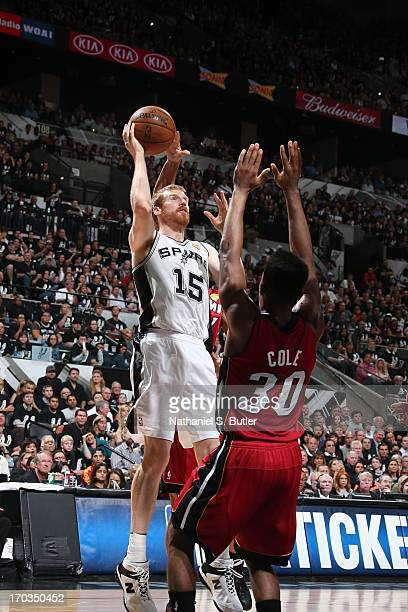 Matt Bonner of the San Antonio Spurs shoots over Norris Cole of the Miami Heat during Game Three of the 2013 NBA Finals on June 11 2013 at the ATT...