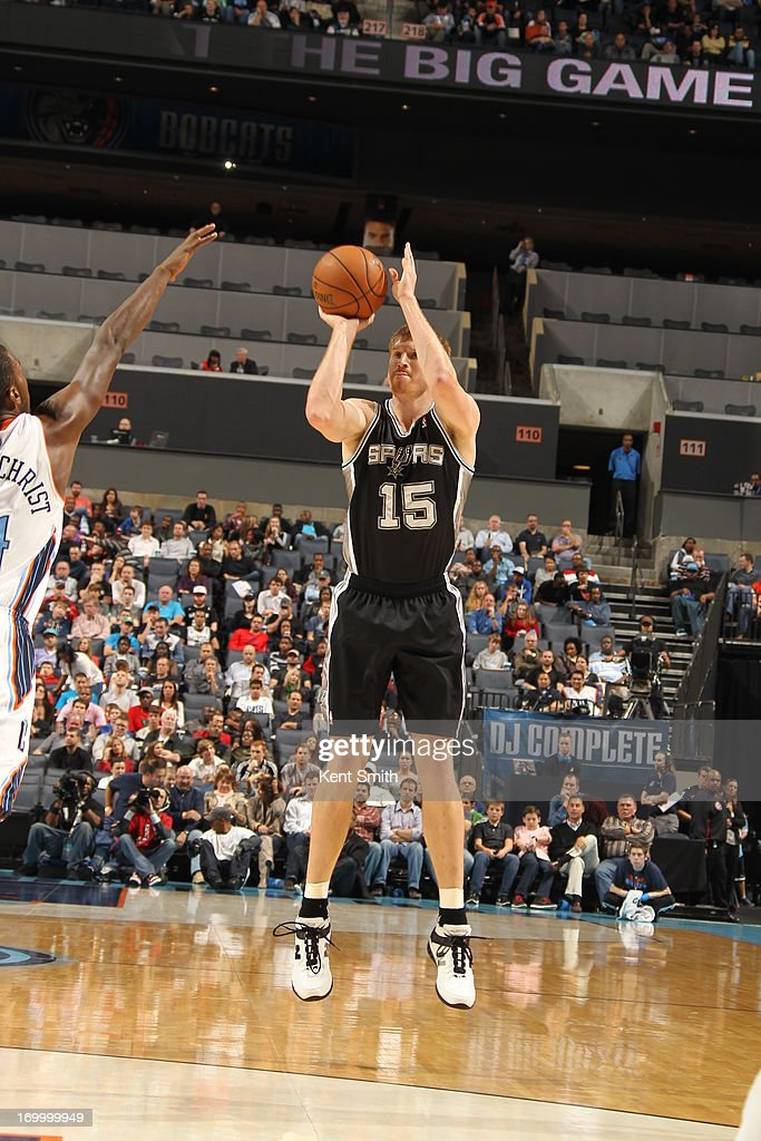 Matt Bonner #15 of the San Antonio Spurs shoots the ball against the Charlotte Bobcats at the Time Warner Cable Arena on December 8, 2012 in Charlotte, North Carolina.