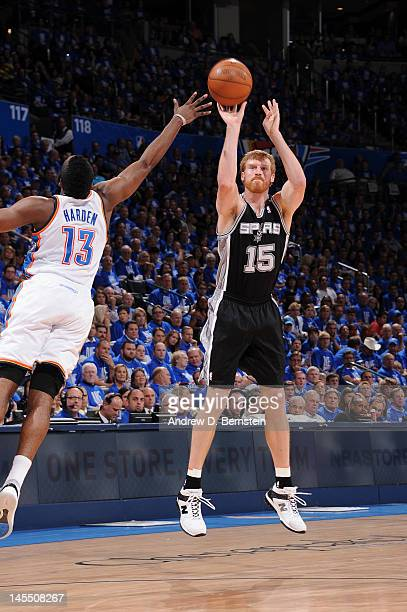 Matt Bonner of the San Antonio Spurs takes a jump shot against James Harden of the Oklahoma City Thunder in Game Three of the Western Conference...