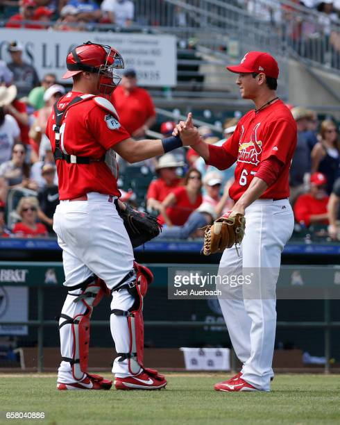 Matt Bowman is congratulated by Carson Kelly of the St Louis Cardinals after the final out in the ninth inning against the Miami Marlins during a...
