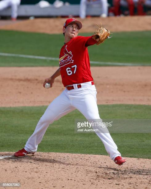 Matt Bowman of the St Louis Cardinals pitches against the Miami Marlins in the eighth inning during a spring training game at Roger Dean Stadium on...