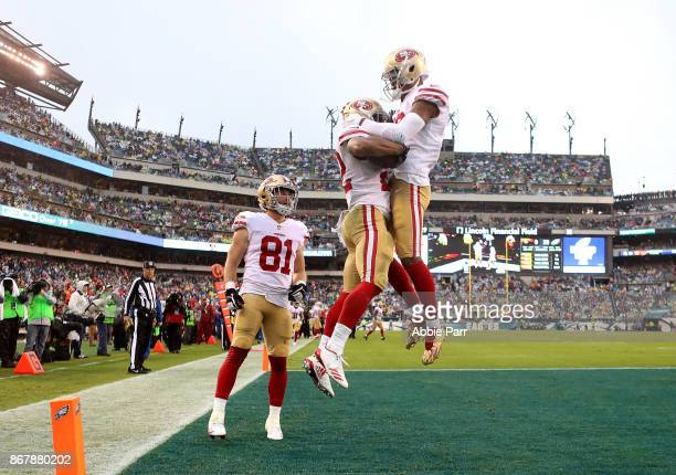 Matt Breida of the San Francisco 49ers celebrates with teammates after scoring a 21 yard touchdown against the Philadelphia Eagles in the third...