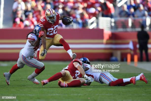Matt Breida of the San Francisco 49ers hurdles players during their NFL game against the New York Giants at Levi's Stadium on November 12 2017 in...