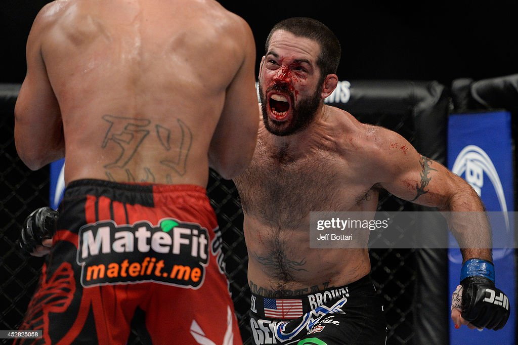 <a gi-track='captionPersonalityLinkClicked' href=/galleries/search?phrase=Matt+Brown+-+Fighter&family=editorial&specificpeople=12802513 ng-click='$event.stopPropagation()'>Matt Brown</a> attacks <a gi-track='captionPersonalityLinkClicked' href=/galleries/search?phrase=Robbie+Lawler&family=editorial&specificpeople=4165234 ng-click='$event.stopPropagation()'>Robbie Lawler</a> in their welterweight bout during the UFC Fight Night event at the SAP Center on July 26, 2014 in San Jose, California.