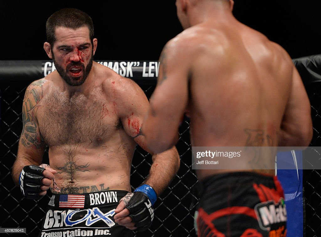 <a gi-track='captionPersonalityLinkClicked' href=/galleries/search?phrase=Matt+Brown+-+Fighter&family=editorial&specificpeople=12802513 ng-click='$event.stopPropagation()'>Matt Brown</a> looks to strike <a gi-track='captionPersonalityLinkClicked' href=/galleries/search?phrase=Robbie+Lawler&family=editorial&specificpeople=4165234 ng-click='$event.stopPropagation()'>Robbie Lawler</a> in their welterweight bout during the UFC Fight Night event at the SAP Center on July 26, 2014 in San Jose, California.