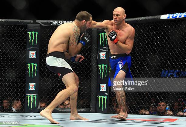 Matt Brown of the United States fights Donald Cerrone of the United States in their Welterweight bout during the UFC 206 event at Air Canada Centre...