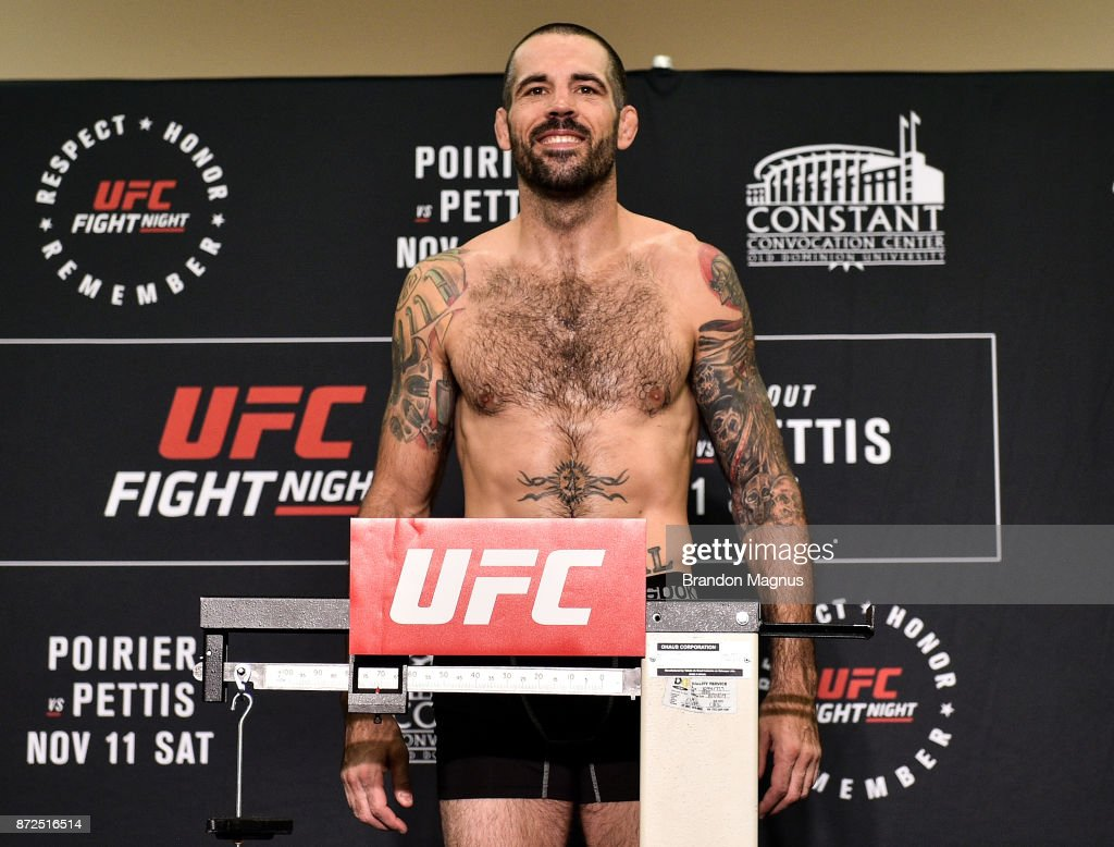 Matt Brown poses on the scale during the UFC Fight Night Weigh-in on November 10, 2017 in Norfolk, Virginia.