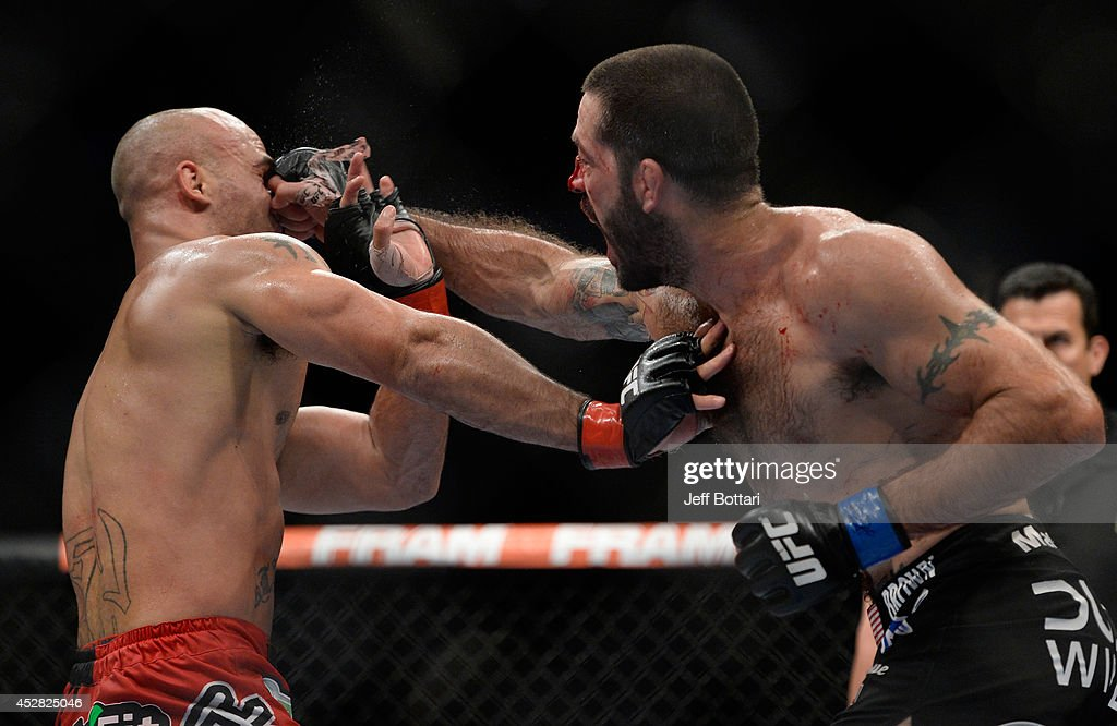 <a gi-track='captionPersonalityLinkClicked' href=/galleries/search?phrase=Matt+Brown+-+Fighter&family=editorial&specificpeople=12802513 ng-click='$event.stopPropagation()'>Matt Brown</a> punches <a gi-track='captionPersonalityLinkClicked' href=/galleries/search?phrase=Robbie+Lawler&family=editorial&specificpeople=4165234 ng-click='$event.stopPropagation()'>Robbie Lawler</a> in their welterweight bout during the UFC Fight Night event at the SAP Center on July 26, 2014 in San Jose, California.