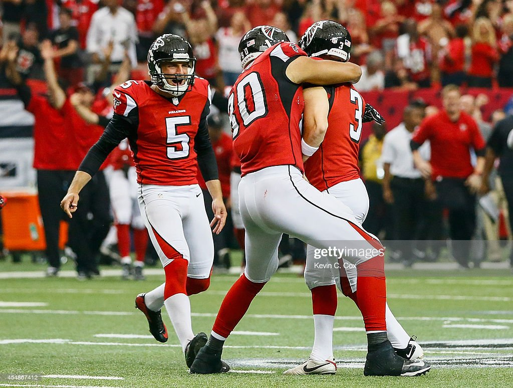Matt Bryant celebrates kicking the game winning field goal with Levine Toilolo and Matt Bosher of the Atlanta Falcons in overtime against the New...