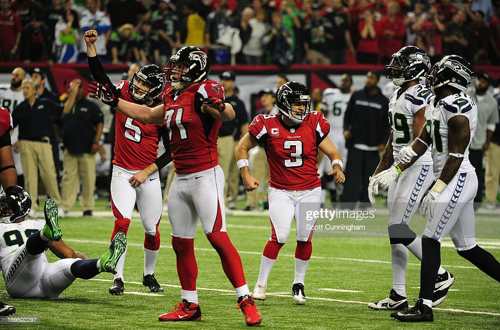 Matt Bryant #3 of the Atlanta Falcons celebrates with Kroy Biermann #71 and Matt Bosher #5 after kicking the game winning field goal against the Seattle Seahawks during the NFC Divisional Playoff Game at the Georgia Dome on January 13, 2013 in Atlanta, Georgia