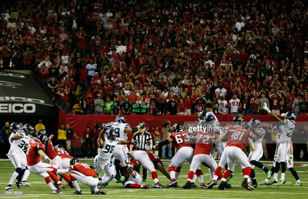 <a gi-track='captionPersonalityLinkClicked' href=/galleries/search?phrase=Matt+Bryant&family=editorial&specificpeople=748514 ng-click='$event.stopPropagation()'>Matt Bryant</a> #3 of the Atlanta Falcons kicks the game winning field goal in the fourth quarter against the Seattle Seahawks during the NFC Divisional Playoff Game at Georgia Dome on January 13, 2013 in Atlanta, Georgia.