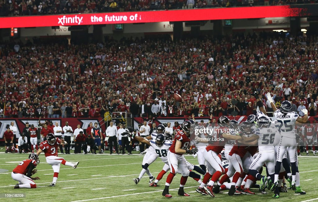Matt Bryant #3 of the Atlanta Falcons kicks the game winning field goal in the fourth quarter against the Seattle Seahawks during the NFC Divisional Playoff Game at Georgia Dome on January 13, 2013 in Atlanta, Georgia.