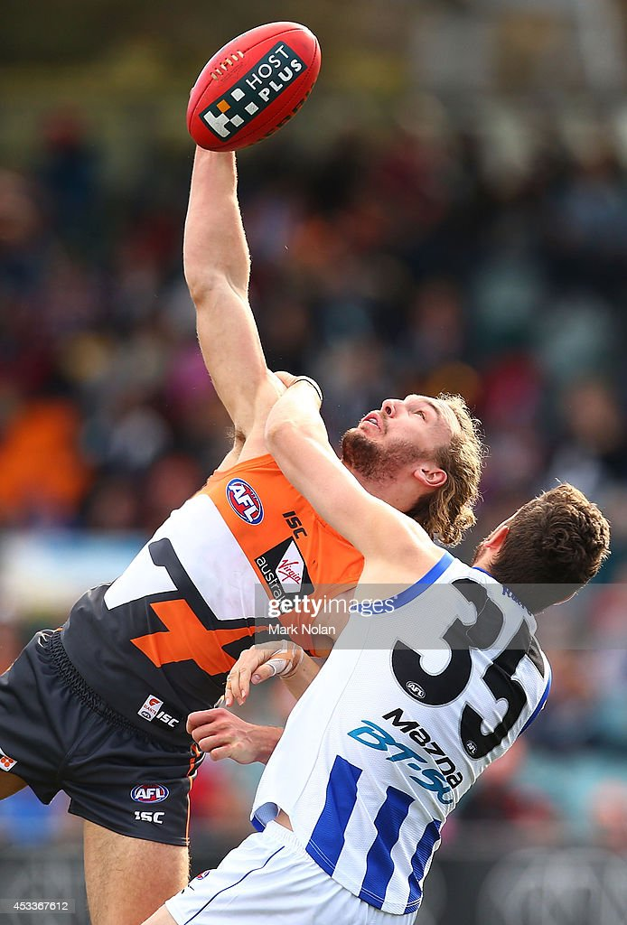 Matt Buntine of the Giants and Aaron Black of the Kangaroos contest possession during the round 20 AFL match between the Greater Western Sydney Giants and the North Melbourne Kangaroos at Stratrack Oval on August 9, 2014 in Canberra, Australia.