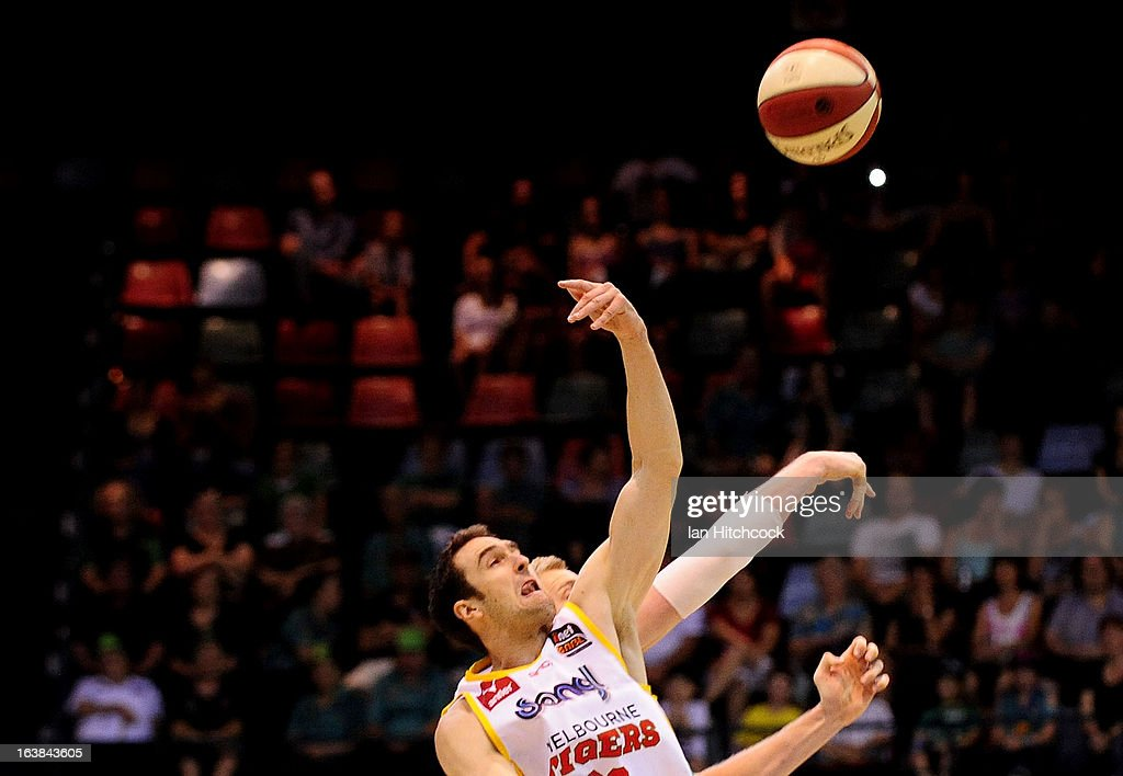 Matt Burston of the Tigers competes with Luke Nevill of the Crocodiles at the tip off during the round 23 NBL match between the Townsville Crocodiles and the Melbourne Tigers at Townsville Entertainment Centre on March 17, 2013 in Townsville, Australia.