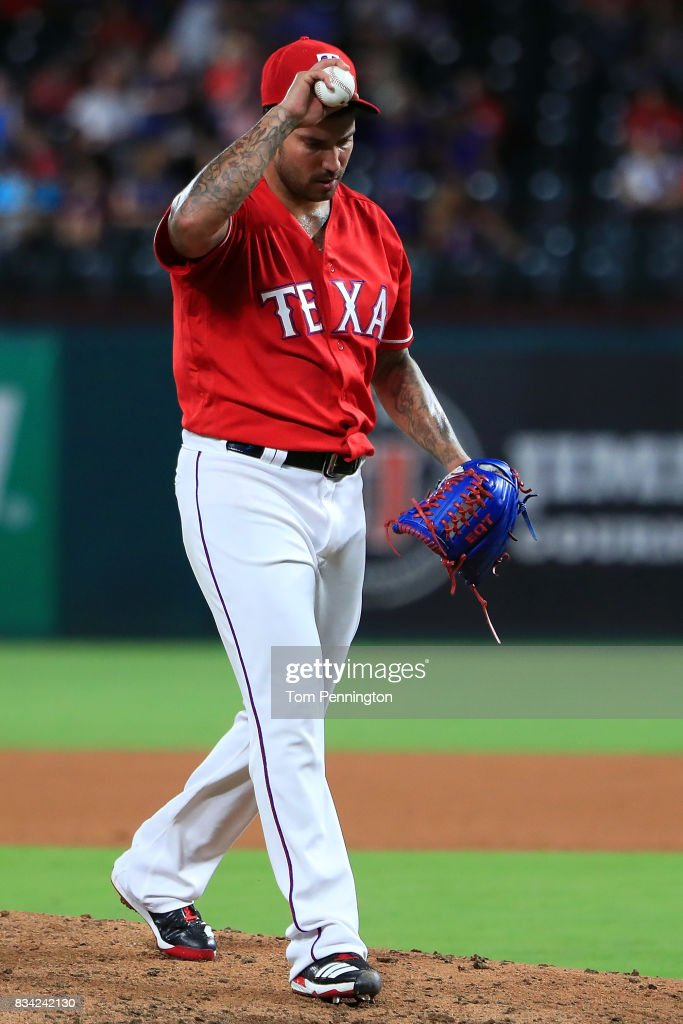 Matt Bush #51 of the Texas Rangers reacts after giving up a run against the Chicago White Sox in the top of the seventh inning at Globe Life Park in Arlington on August 17, 2017 in Arlington, Texas.