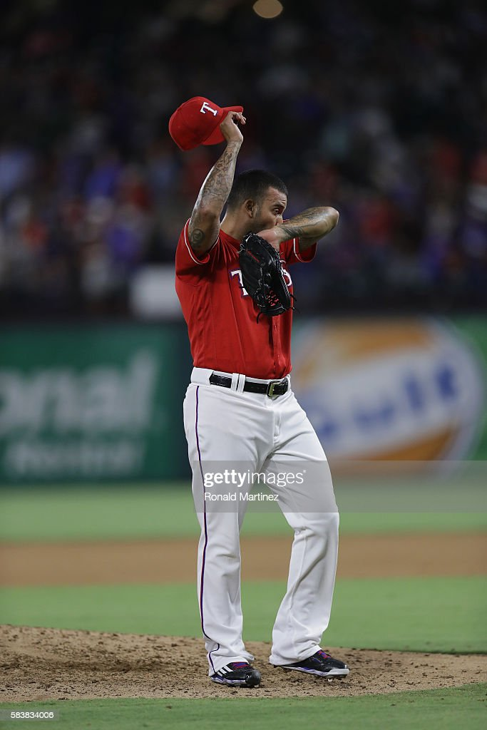 Matt Bush #51 of the Texas Rangers reacts after giving up a two-run homerun against Coco Crisp #4 of the Oakland Athletics in the eighth inning at Globe Life Park in Arlington on July 27, 2016 in Arlington, Texas.