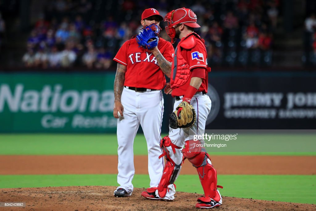 Matt Bush #51 of the Texas Rangers talks with Brett Nicholas #6 of the Texas Rangers after giving up a run against the Chicago White Sox in the top of the seventh inning at Globe Life Park in Arlington on August 17, 2017 in Arlington, Texas.