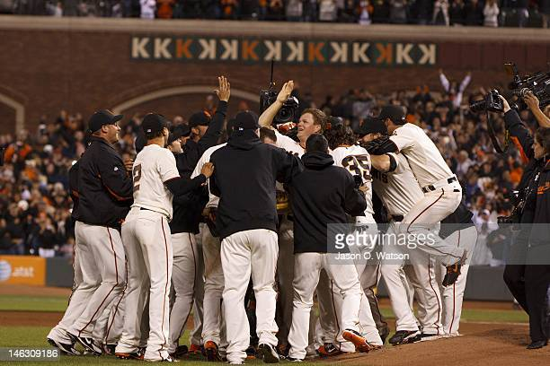 Matt Cain of the San Francisco Giants celebrates after pitching a perfect game against the Houston Astros at ATT Park on June 13 2012 in San...