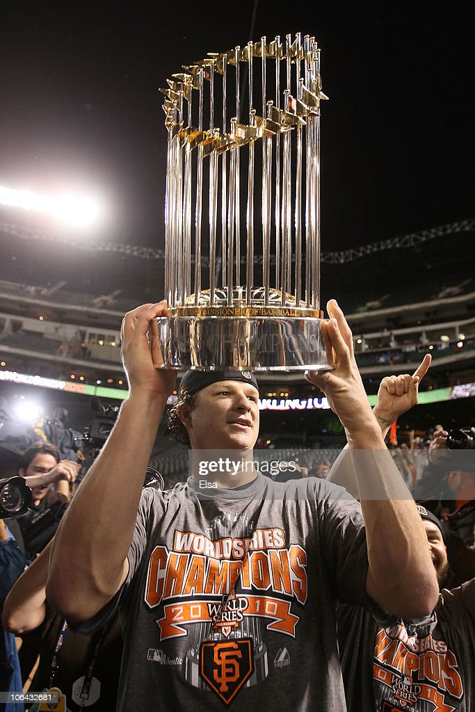 Matt Cain of the San Francisco Giants celebrates with the World Series Championship trophy out to the field after they won 3-1 against the Texas Rangers in Game Five of the 2010 MLB World Series at Rangers Ballpark in Arlington on November 1, 2010 in Arlington, Texas.