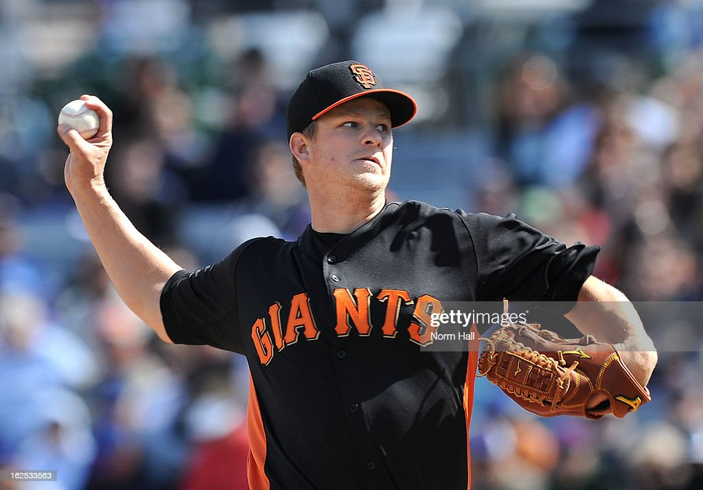 <a gi-track='captionPersonalityLinkClicked' href=/galleries/search?phrase=Matt+Cain&family=editorial&specificpeople=534602 ng-click='$event.stopPropagation()'>Matt Cain</a> #18 of the San Francisco Giants delivers a pitch against the Chicago Cubs at HoHoKam Park on February 24, 2013 in Mesa, Arizona.