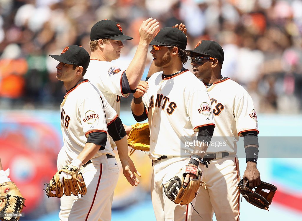 <a gi-track='captionPersonalityLinkClicked' href=/galleries/search?phrase=Matt+Cain&family=editorial&specificpeople=534602 ng-click='$event.stopPropagation()'>Matt Cain</a> #18 of the San Francisco Giants is congratulated by Brandon Crawford #35, <a gi-track='captionPersonalityLinkClicked' href=/galleries/search?phrase=Freddy+Sanchez&family=editorial&specificpeople=220611 ng-click='$event.stopPropagation()'>Freddy Sanchez</a> #21 and <a gi-track='captionPersonalityLinkClicked' href=/galleries/search?phrase=Miguel+Tejada&family=editorial&specificpeople=202227 ng-click='$event.stopPropagation()'>Miguel Tejada</a> #10 after they beat the Washington Nationals at AT&T Park on June 8, 2011 in San Francisco, California.