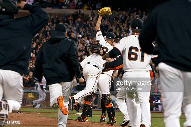 Matt Cain of the San Francisco Giants is congratulated by Buster Posey and teammates after pitching a perfect game against the Houston Astros at ATT...