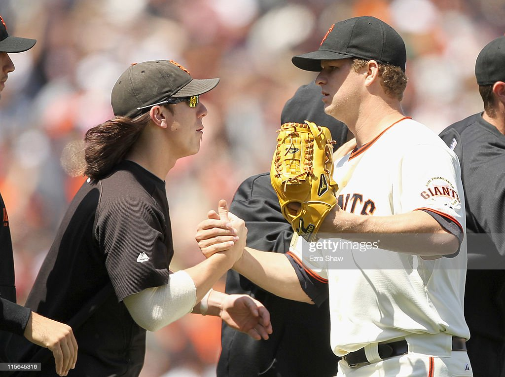 <a gi-track='captionPersonalityLinkClicked' href=/galleries/search?phrase=Matt+Cain&family=editorial&specificpeople=534602 ng-click='$event.stopPropagation()'>Matt Cain</a> #18 of the San Francisco Giants is congratulated by <a gi-track='captionPersonalityLinkClicked' href=/galleries/search?phrase=Tim+Lincecum&family=editorial&specificpeople=4175405 ng-click='$event.stopPropagation()'>Tim Lincecum</a> #55 of the San Francisco Giants after they beat the Washington Nationals at AT&T Park on June 8, 2011 in San Francisco, California.