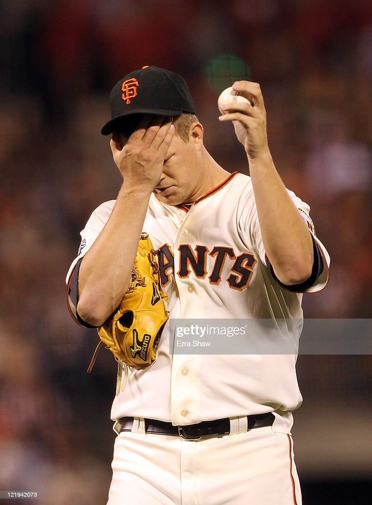 <a gi-track='captionPersonalityLinkClicked' href=/galleries/search?phrase=Matt+Cain&family=editorial&specificpeople=534602 ng-click='$event.stopPropagation()'>Matt Cain</a> #18 of the San Francisco Giants rubs his head during the seventh inning of their game against the San Diego Padres at AT&T Park on August 23, 2011 in San Francisco, California.