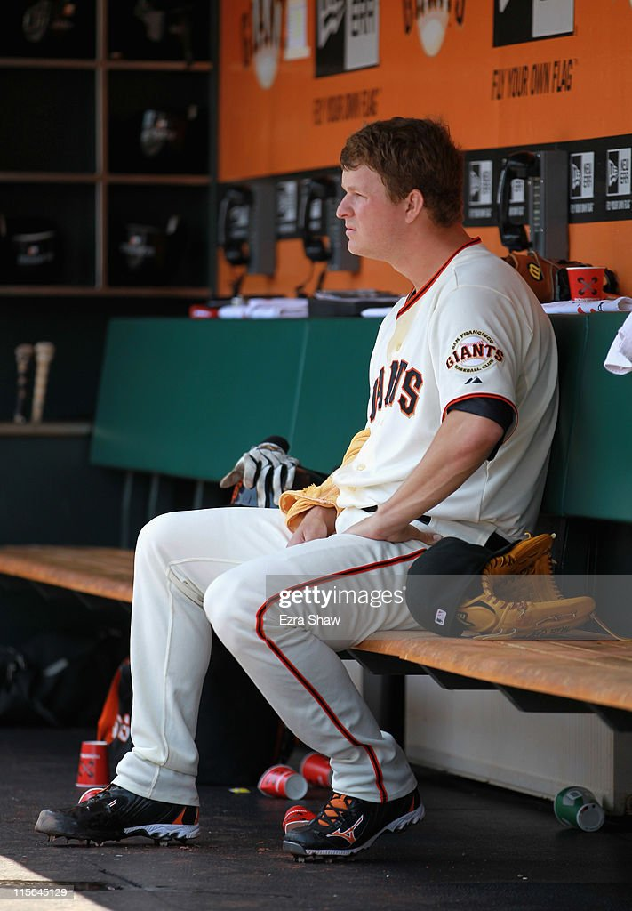 <a gi-track='captionPersonalityLinkClicked' href=/galleries/search?phrase=Matt+Cain&family=editorial&specificpeople=534602 ng-click='$event.stopPropagation()'>Matt Cain</a> #18 of the San Francisco Giants sits in the dugout during their game against the Washington Nationals at AT&T Park on June 8, 2011 in San Francisco, California.