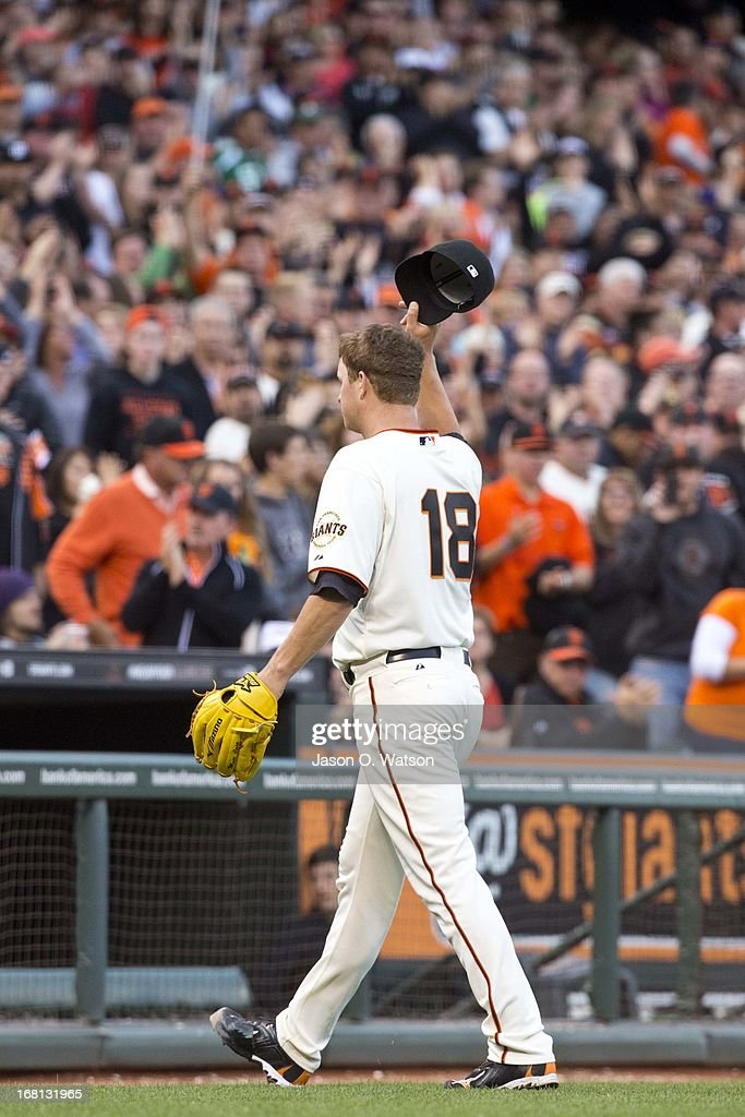 <a gi-track='captionPersonalityLinkClicked' href=/galleries/search?phrase=Matt+Cain&family=editorial&specificpeople=534602 ng-click='$event.stopPropagation()'>Matt Cain</a> #18 of the San Francisco Giants tips his hat to the crowd after being relieved against the Los Angeles Dodgers during the eighth inning at AT&T Park on May 5, 2013 in San Francisco, California.
