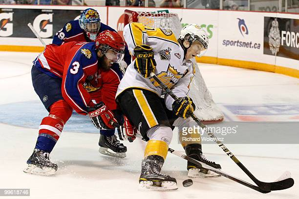 Matt Calvert of the Brandon Wheat Kings loses control of the puck while being defended by Brandon Gormley of the Moncton Wildcats during the 2010...