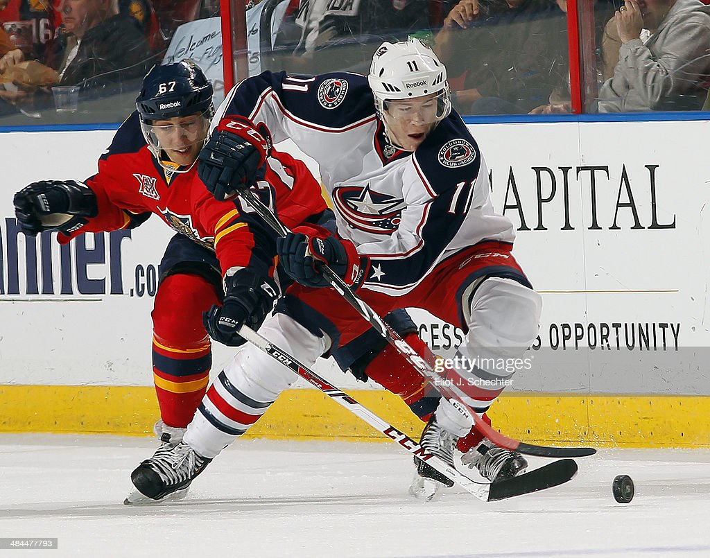 Matt Calvert #11 of the Columbus Blue Jackets crosses sticks with <a gi-track='captionPersonalityLinkClicked' href=/galleries/search?phrase=Vincent+Trocheck&family=editorial&specificpeople=6675079 ng-click='$event.stopPropagation()'>Vincent Trocheck</a> #67 of the Florida Panthers at the BB&T Center on April 12, 2014 in Sunrise, Florida.