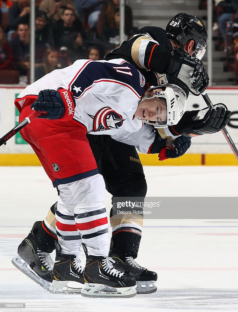 Matt Calvert #11 of the Columbus Blue Jackets gets tangled up with <a gi-track='captionPersonalityLinkClicked' href=/galleries/search?phrase=Francois+Beauchemin&family=editorial&specificpeople=604125 ng-click='$event.stopPropagation()'>Francois Beauchemin</a> #23 of the Anaheim Ducks on April 17, 2013 at Honda Center in Anaheim, California.