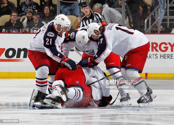 Matt Calvert of the Columbus Blue Jackets is congratulated by teammates after his game winninggoal against the Pittsburgh Penguins in Game Two of the...