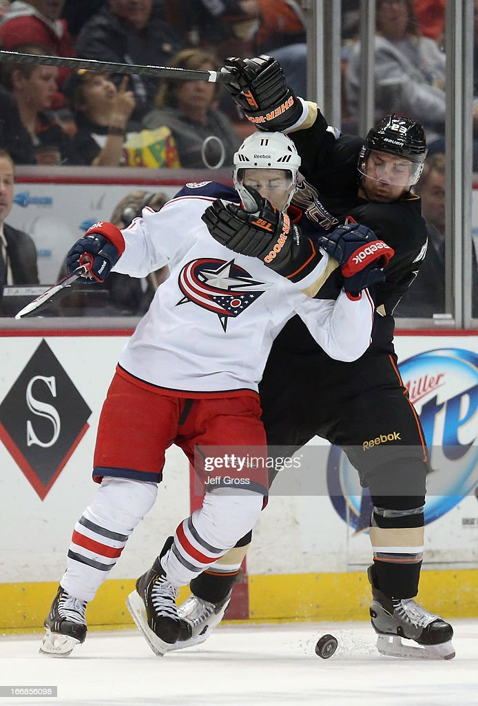 Matt Calvert #11 of the Columbus Blue Jackets is tied up by <a gi-track='captionPersonalityLinkClicked' href=/galleries/search?phrase=Francois+Beauchemin&family=editorial&specificpeople=604125 ng-click='$event.stopPropagation()'>Francois Beauchemin</a> #23 of the Anaheim Ducks in the third period at Honda Center on April 17, 2013 in Anaheim, California. The Blue Jackets defeated the Ducks 3-2 in overtime.