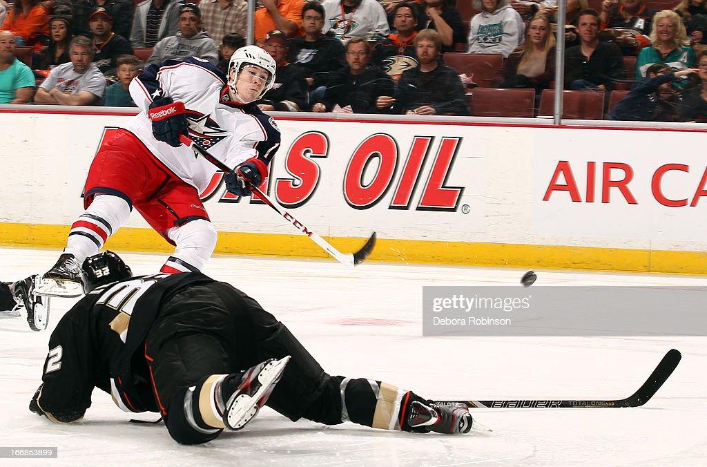 Matt Calvert #11 of the Columbus Blue Jackets shoots the puck past a fallen Toni Lydman #32 of the Anaheim Ducks on April 17, 2013 at Honda Center in Anaheim, California.