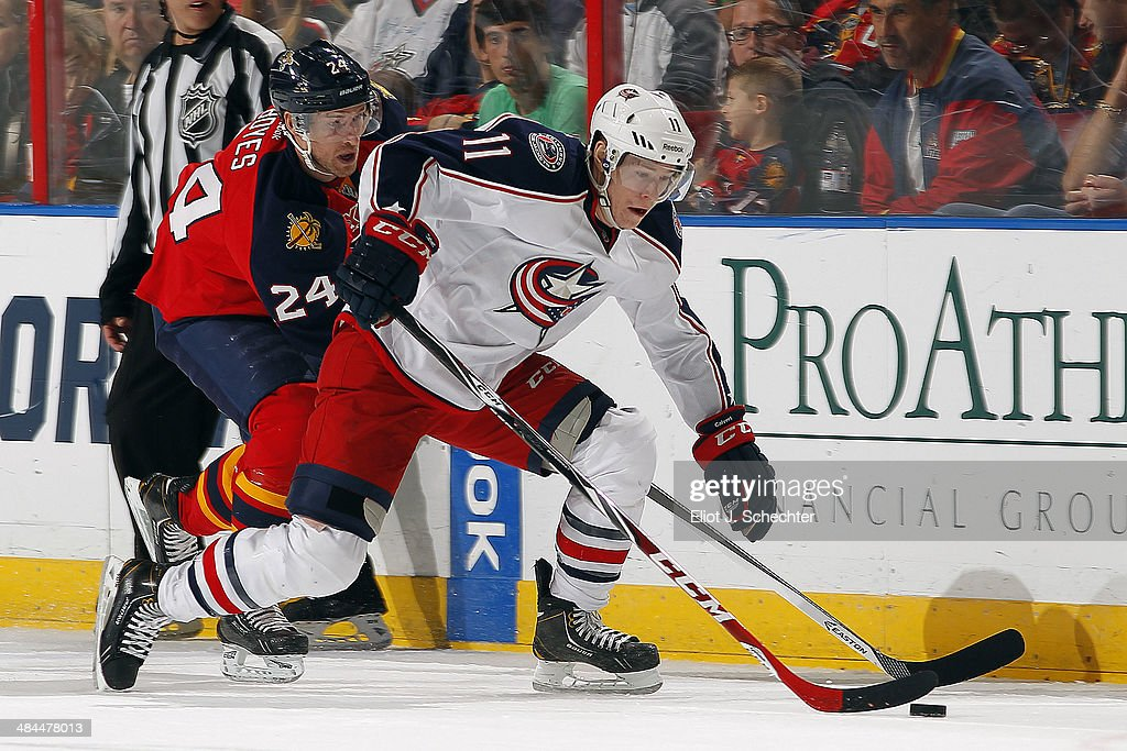 Matt Calvert #11 of the Columbus Blue Jackets skates with the puck against <a gi-track='captionPersonalityLinkClicked' href=/galleries/search?phrase=Brad+Boyes&family=editorial&specificpeople=275014 ng-click='$event.stopPropagation()'>Brad Boyes</a> #24 of the Florida Panthers at the BB&T Center on April 12, 2014 in Sunrise, Florida.