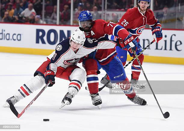 Matt Calvert of the Columbus Blue Jackets tries to keep the puck from PK Subban of the Montreal Canadiens in the NHL game at the Bell Centre on...