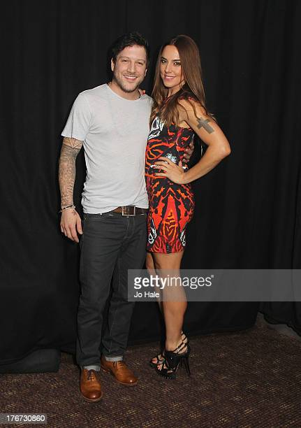 Matt Cardle and Melanie Chisolm pose backstage at GAY on August 17 2013 in London England