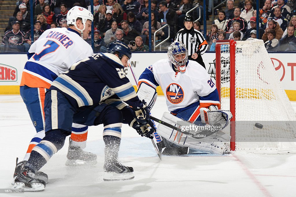 <a gi-track='captionPersonalityLinkClicked' href=/galleries/search?phrase=Matt+Carkner&family=editorial&specificpeople=556901 ng-click='$event.stopPropagation()'>Matt Carkner</a> #7 of the New York Islanders and <a gi-track='captionPersonalityLinkClicked' href=/galleries/search?phrase=Derek+MacKenzie&family=editorial&specificpeople=685877 ng-click='$event.stopPropagation()'>Derek MacKenzie</a> #24 of the Columbus Blue Jackets battle for a loose puck as goaltender <a gi-track='captionPersonalityLinkClicked' href=/galleries/search?phrase=Evgeni+Nabokov&family=editorial&specificpeople=171380 ng-click='$event.stopPropagation()'>Evgeni Nabokov</a> #20 of the New York Islanders defends the net on November 9, 2013 at Nationwide Arena in Columbus, Ohio. Columbus defeated New York 5-2.