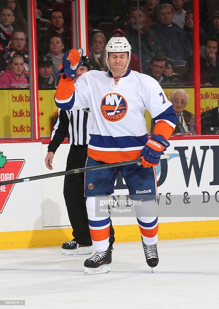 <a gi-track='captionPersonalityLinkClicked' href=/galleries/search?phrase=Matt+Carkner&family=editorial&specificpeople=556901 ng-click='$event.stopPropagation()'>Matt Carkner</a> #7 of the New York Islanders pumps his fist to celebrate his assist on a second period goal against the Ottawa Senators at Canadian Tire Centre on November 1, 2013 in Ottawa, Ontario, Canada.