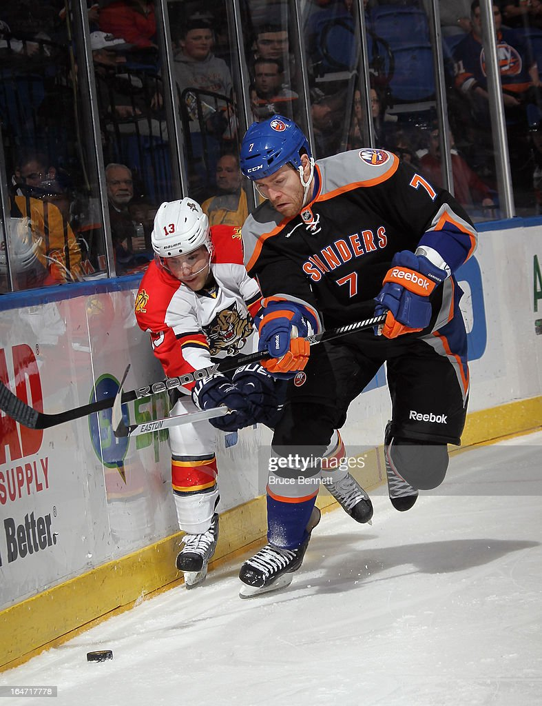 <a gi-track='captionPersonalityLinkClicked' href=/galleries/search?phrase=Matt+Carkner&family=editorial&specificpeople=556901 ng-click='$event.stopPropagation()'>Matt Carkner</a> #7 of the New York Islanders skates against the Florida Panthers at the Nassau Veterans Memorial Coliseum on March 24, 2013 in Uniondale, New York. The Islanders defeated the Panthers 3-0.