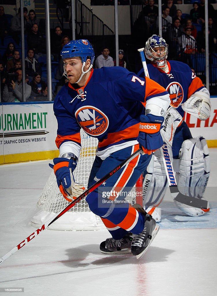 Matt Carkner #7 of the New York Islanders skates against the Pittsburgh Penguins at the Nassau Veterans Memorial Coliseum on February 5, 2013 in Uniondale, New York.