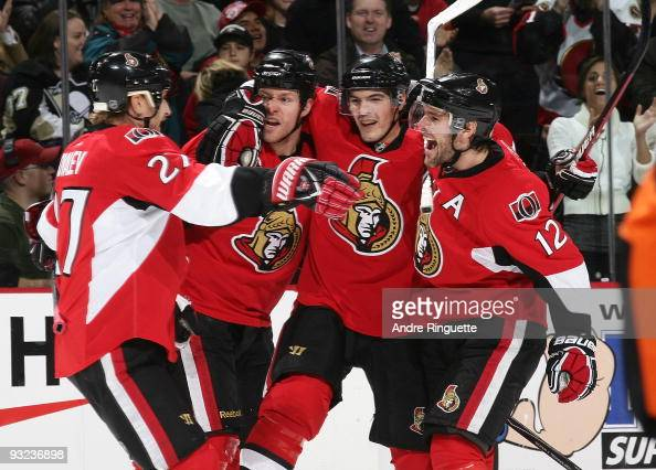 Matt Carkner of the Ottawa Senators celebrates his first period goal against the Pittsburgh Penguins with teammates Alexei Kovalev Alexandre Picard...