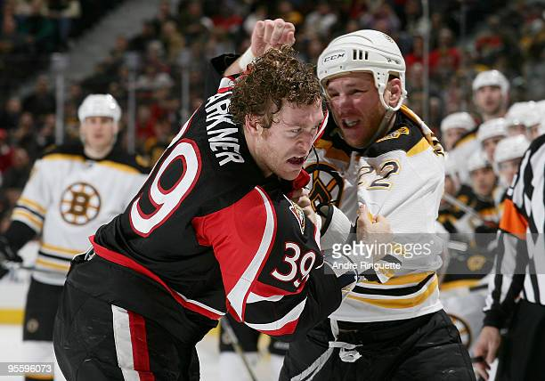 Matt Carkner of the Ottawa Senators fights with Shawn Thornton of the Boston Bruins at Scotiabank Place on January 5 2010 in Ottawa Ontario Canada