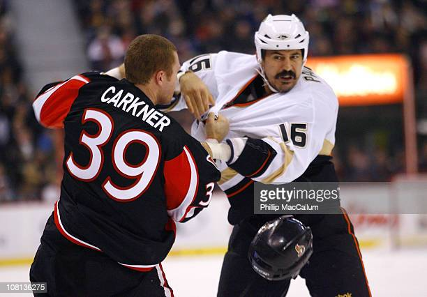 Matt Carkner of the Ottawa Senators looses his helmet in a fight with George Parros of the Anaheim Ducks in a game at Scotiabank Place on January 18...