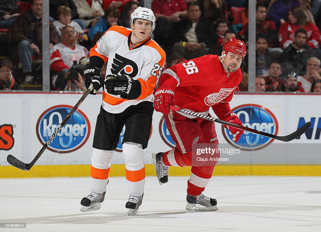 <a gi-track='captionPersonalityLinkClicked' href=/galleries/search?phrase=Matt+Carle&family=editorial&specificpeople=582495 ng-click='$event.stopPropagation()'>Matt Carle</a> #25 of the Philadelphia Flyers clears the puck away from <a gi-track='captionPersonalityLinkClicked' href=/galleries/search?phrase=Tomas+Holmstrom&family=editorial&specificpeople=203288 ng-click='$event.stopPropagation()'>Tomas Holmstrom</a> #96 of the Detroit Red Wings in a game on January 2, 2011 at the Joe Louis Arena in Detroit, Michigan. The Flyers defeated the Wings 3-2.