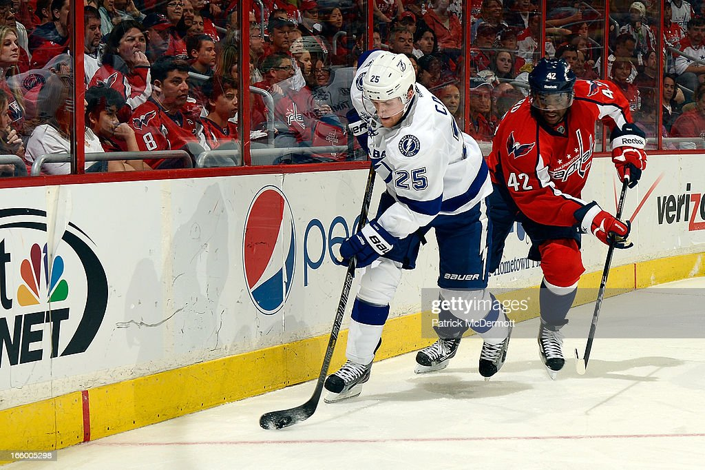 <a gi-track='captionPersonalityLinkClicked' href=/galleries/search?phrase=Matt+Carle&family=editorial&specificpeople=582495 ng-click='$event.stopPropagation()'>Matt Carle</a> #25 of the Tampa Bay Lightning battles for the puck against Joel Ward #42 of the Washington Capitals during an NHL game at Verizon Center on April 7, 2013 in Washington, DC.