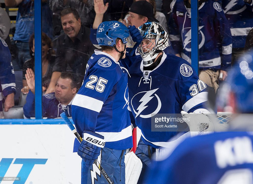 <a gi-track='captionPersonalityLinkClicked' href=/galleries/search?phrase=Matt+Carle&family=editorial&specificpeople=582495 ng-click='$event.stopPropagation()'>Matt Carle</a> #25 of the Tampa Bay Lightning congratulates goalie <a gi-track='captionPersonalityLinkClicked' href=/galleries/search?phrase=Ben+Bishop&family=editorial&specificpeople=700137 ng-click='$event.stopPropagation()'>Ben Bishop</a> #30 on his win against the Ottawa Senators at the Tampa Bay Times Forum on December 5, 2013 in Tampa, Florida.